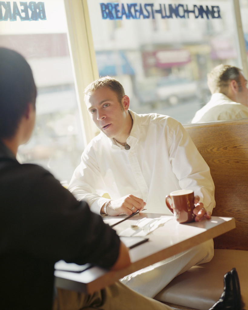 Two Men Talking in Restaurant